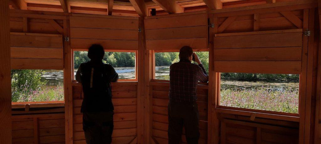 Photo of people in a bird hide.